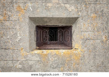 Rusted Loophole In Old Concrete Bunker Wall