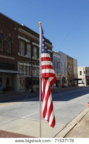 American Flag Displayed Along Main Street