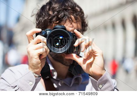 Close-up of a photographer using his camera