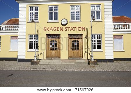The old Central Station at Skagen (Denmark North Jutland) is built in the typical architectural style and colors with ochraceous walls a red roof and white joints. poster