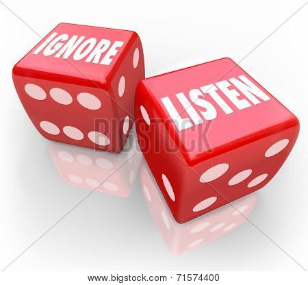 Listen and Ignore words on two red 3d dice to illustrate the choice to pay attention or avoid listening to a person or group