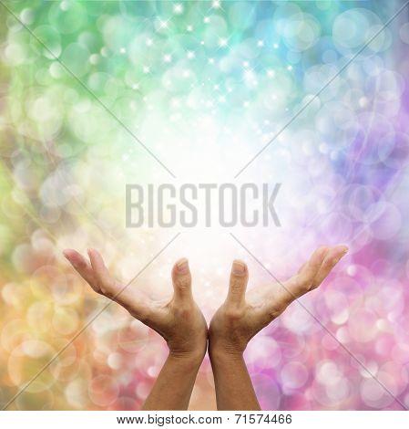 Rainbow healing energy on bokeh background