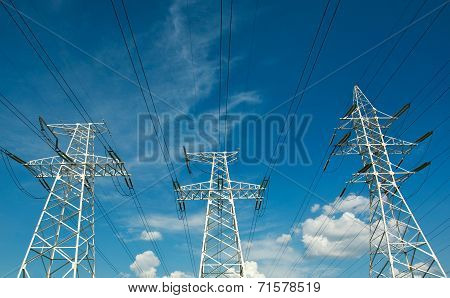 Electric Line Power Tower On Background Blue Sky