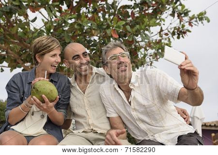Middle aged group of friends taking a selfie with phone
