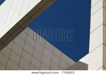 Modern white building under beautiful blue sky