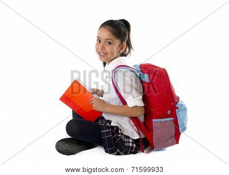 Happy Latin Child Reading Textbook Or Notepad Smiling Sitting On The Floor