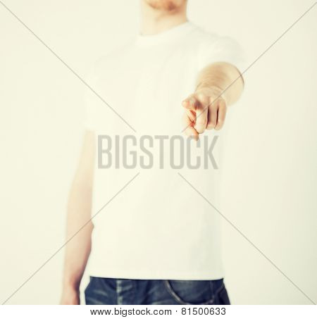 close up of man pointing his finger at you