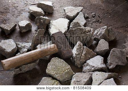 Concrete rubble debris with hammer