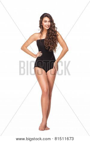 Smiling young woman in black swimsuit