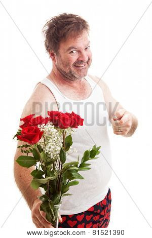 Scruffy unshaven husband in his underwear with red roses for Valentines Day.  Isolated on white.