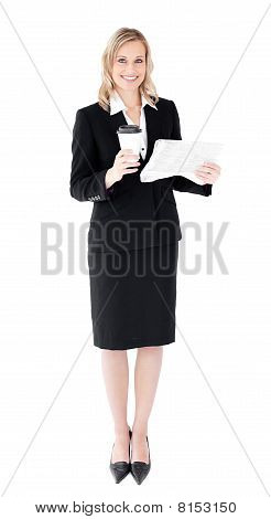 A Beautiful Businesswoman Holding A Cup Of Coffee Reading A Newspaper