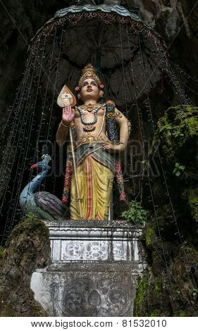 KUALA LUMPUR, MALAYSIA - JANUARY 31, 2015: A statue of Lord Muruga stands inside the Sri Mahamarriamman temple built inside a limestone cave. Hundreds of thousands of devotees come here for Thaipusam.