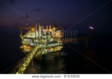 oil and gas construction in night view. View from helicopter night flight.