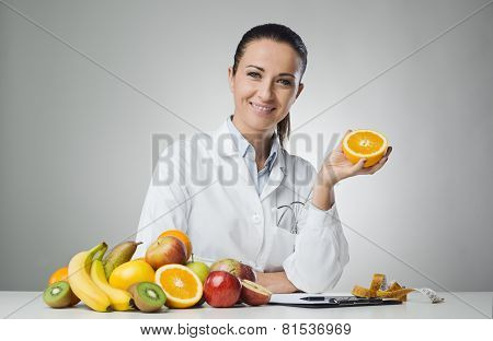 Dietician Holding An Orange