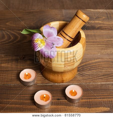 Wooden bamboo pounder with candles