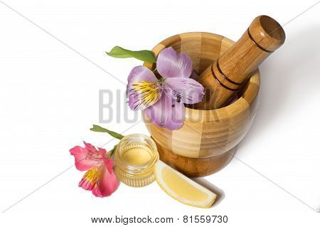 Wooden bamboo pounder with flowers isolated