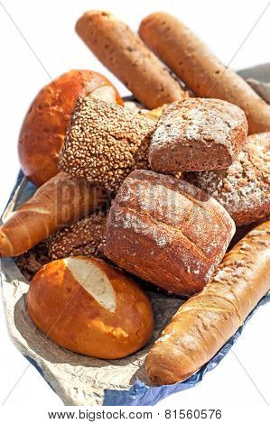 Baked biscuits and baguette bread  on white background