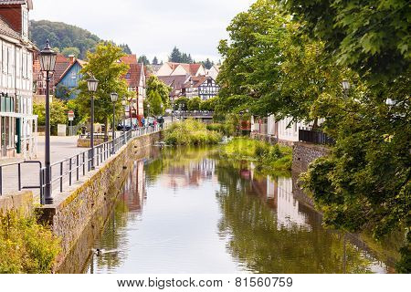 Historic German City With A River And Fachwerkhaus Buildings