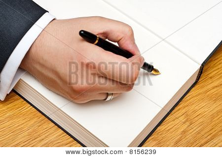 man signing a book