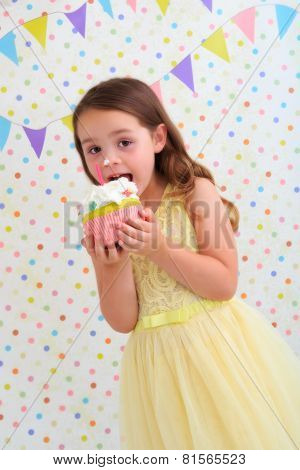 Child about to eat a birthday cake