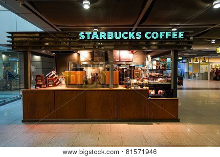 DUSSELDORF - SEPTEMBER 16: airport Starbucks cafe on September 16, 2014 in Dusseldorf, Germany. Starbucks is the largest coffeehouse company in the world, with more then 23000 stores