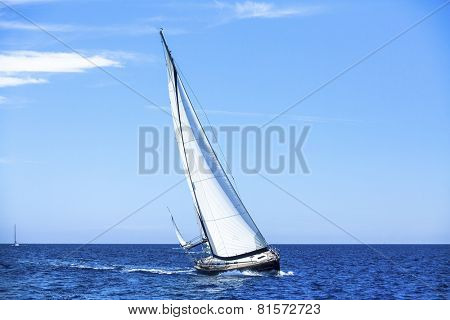 Sailing in the wind through the waves. Sailing boats at the Mediteranean sea.