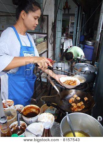 Thai lady cooking foods in Bangkok.