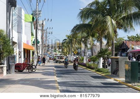 ISLA MUJERES - JANUARY 21: The main street  close to the beach and harbour on 21 January 2015 in Isla Mujeres, Mexico. The island is located 8 miles east of Cancun in the Gulf of Mexico.