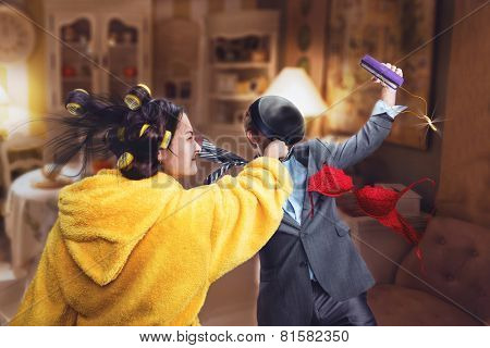 Woman beats her husband with pan poster
