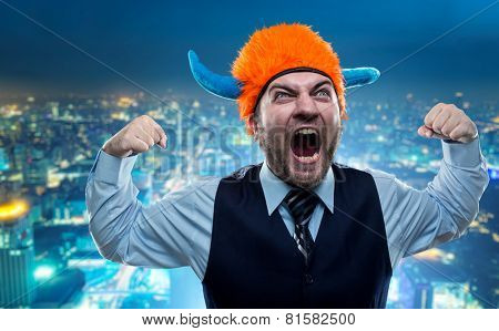 Businessman in party helmet shouting poster