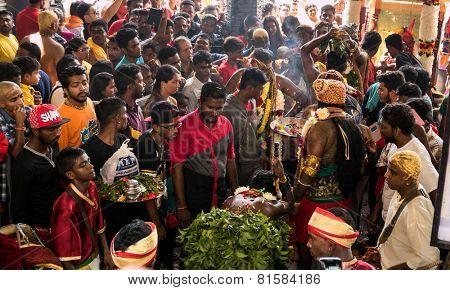 KUALA LUMPUR, MALAYSIA - JANUARY 31, 2015: Hindu devotees perform prayers at the Sri Mahamarriamman temple inside Batu Caves. Hundreds of thousands of devotees come here for the Thaipusam prayers.