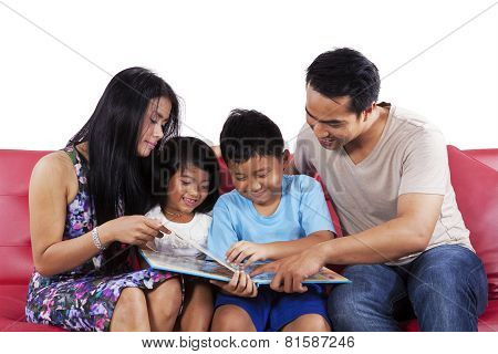 Parents Read A Story Book For Children