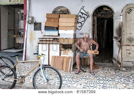 Elderly Man Working In The Street