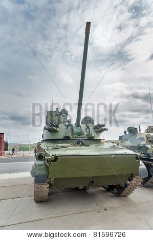 Nizhniy Tagil, Russia - September 25 2013: Visitors examine military equipment on exhibition range.Airborne tracked armoured personnel carrier BMD-4M with additional protection shows gun angle of lead poster