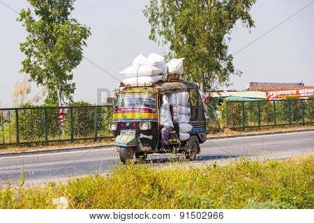 Public Transport In India .crazy Road Scene -truck With Overloaded Cargo