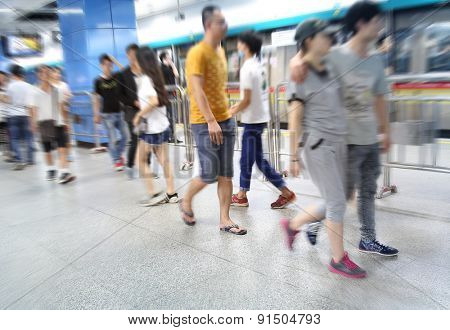 the crowd of a subway station.
