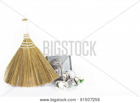 isolated besom and wastebasket with white waste paper poster