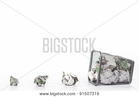 isolated fallen wastebasket full of white waste paper