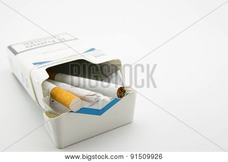 Two Cigarettes And A Hand-rolled Cigarette