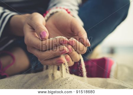 The Sand In The Female Palms On The Beach