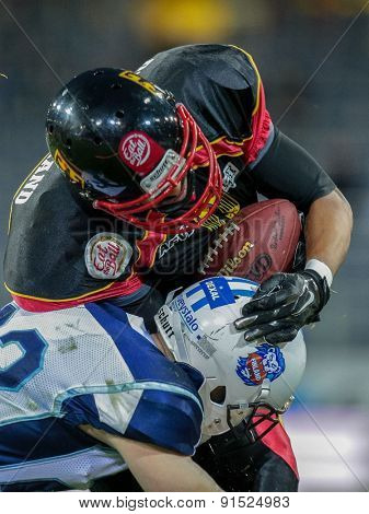 ST. POELTEN, AUSTRIA - MAY 30, 2014: WR Joseph Joyner (#9 Germany) is tackled by an opponent from Finland during the EFAF European Championships 2014 in Austria.