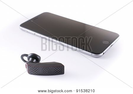 Modern Wireless Jawbone Bluetooth Headset With An Iphone