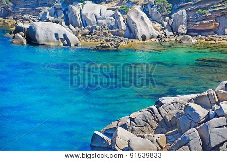 Grey Rocks And Golden Sand In Capo Testa Coastline