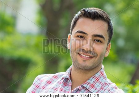 Portrait Of A Laughing Young Man. Close Up Outside Shot Of Happy Gorgeous Guy.