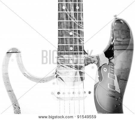 Man Holding A Guitar And Guitar Silhouette In Double Exposure In Bw