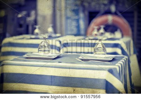 Vintage photo of glasses on a dining table