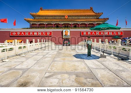 BEIJING, CHINA - JUNE 27, 2014: A soldier guards the Tiananmen Gate at Tiananmen Square.
