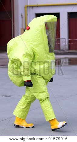Man With Yellow Protective Suit Against Biological Risk