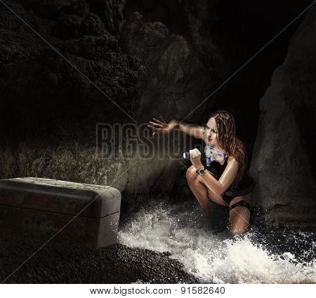 Woman Traveler In Sea Cave With Tresure Chest