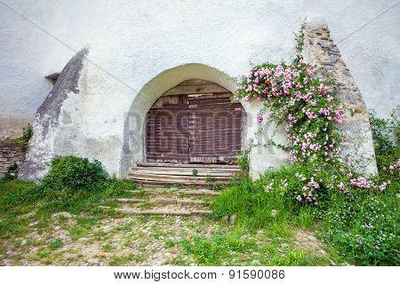 Fortified Church Entrace Gate At Viscri In Transylvania